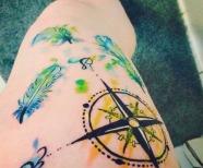 Compass tattoos on legs