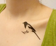Elegant bird tattoo