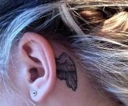 Girl's ears tattoos