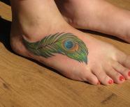 Gorgeous peacocks tattoos on legs
