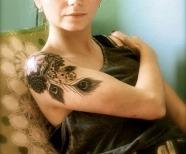 Peacocks tattoos on shoulders