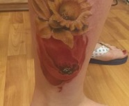 Poppies tattoos on legs