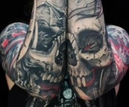 Skull tattoos on shoulder
