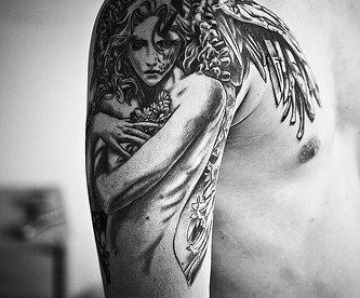 Awesome looking wings tattoos on arm