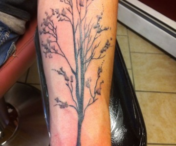 Black trees tattoos
