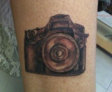 Cameras tattoos on legs