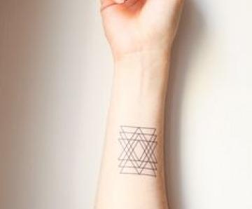Triangle tattoos on arm