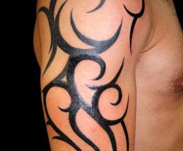 Tribal tattoos on arms