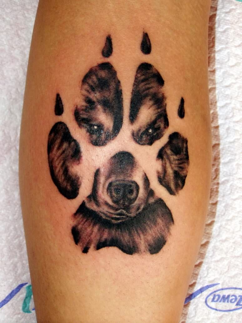 http://tattoomagz.com/paw-print-tattoo-meaning/paw-and-wolf-image-in-paw-tattoo/