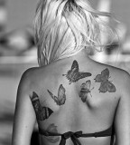 black and white photo buttreflies back tattoo