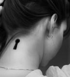 black and white photo key hole back neck tattoo