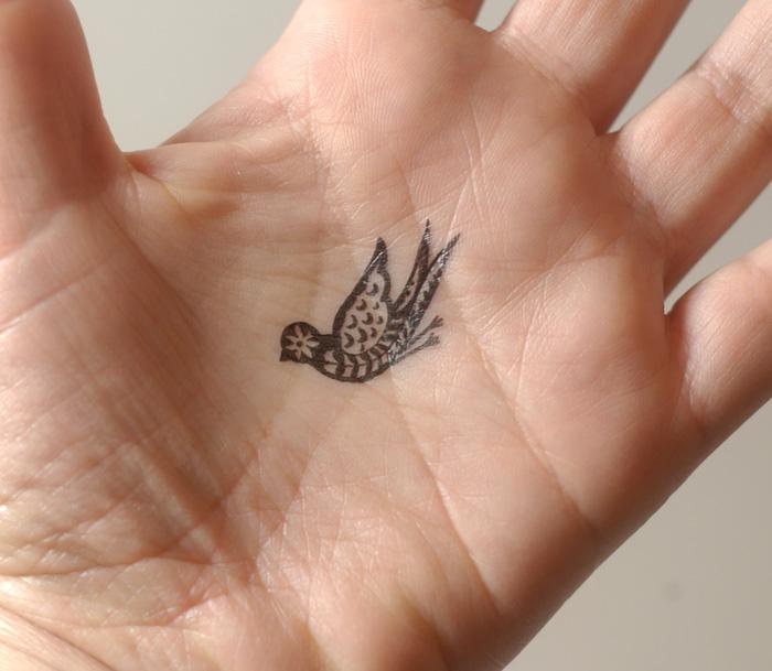 Elegant Bird Tattoo On Hand Tattoomagz