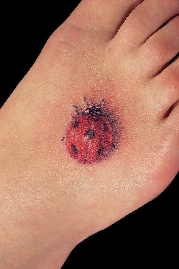 realistic tattoo lady bug on foot