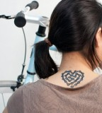 travel tattoo bike chain heart