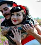 cute tattoed couple fancy moustache
