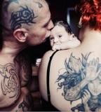 tattooed couple family photo