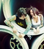 tattooed couple laughing girl
