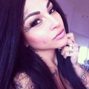 simple women face tattoo