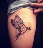 marie kraus tattoo bird on leg