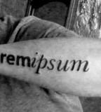 typographic arm tattoo lorem ipsum