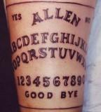 typographic tattoo the quija board