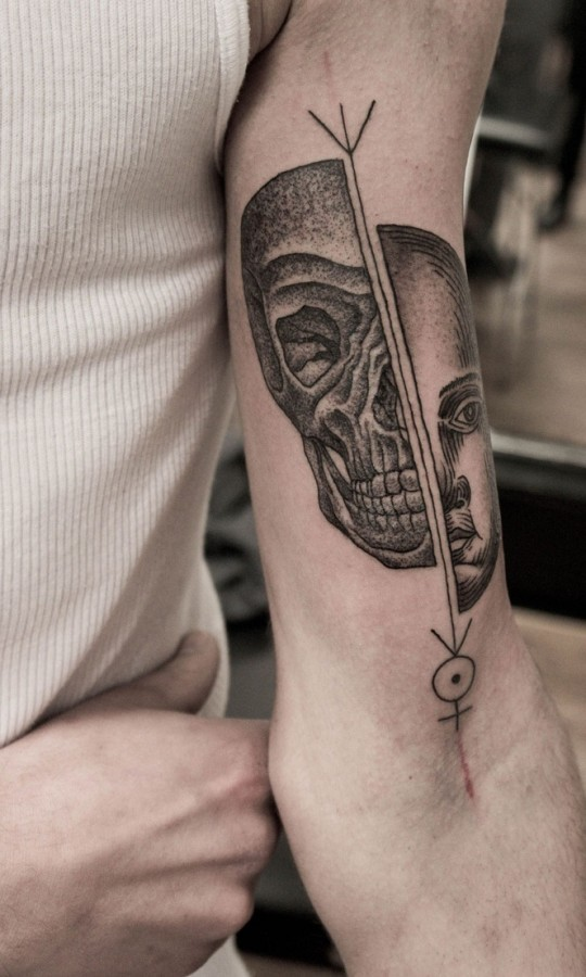 half face and half skull tattoo by m x m