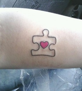 Cute puzzle tattoo