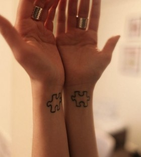 Hands puzzle tattoo