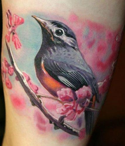 Pretty bird photorealistic tattoo - TattooMagz