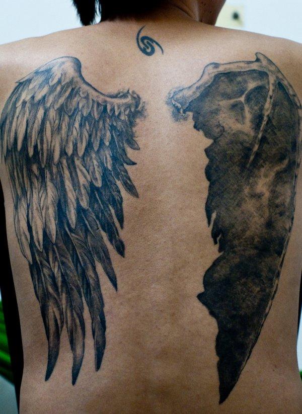 Simple back angel wings tattoo - TattooMagz