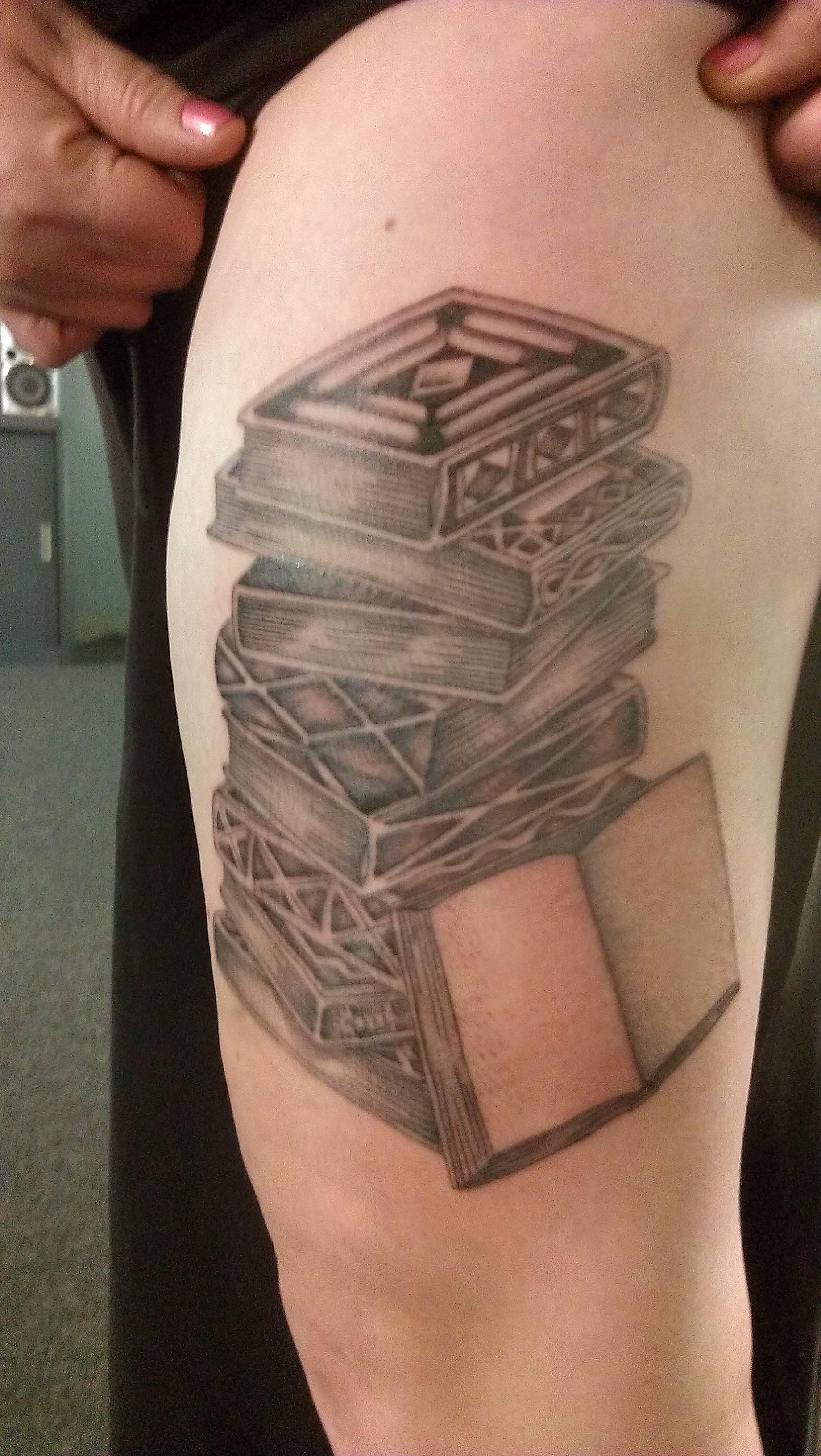 Beautiful tattoo of black books - TattooMagz Tattoos Of Books