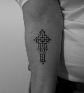 Cross tattoo by Jean Philippe Burton