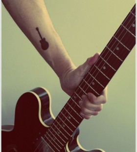 Black small guitar music style tattoo