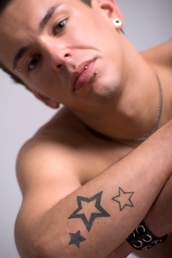 Hand Star Tattoo Designs