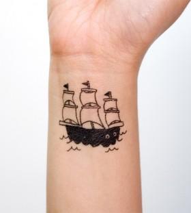 Pretty small ship tattoo