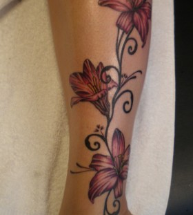 Red flowers legs tattoo