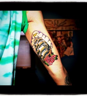 Red rose and green ship tattoo