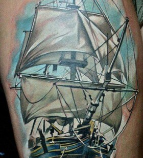 Simple blue ship tattoo