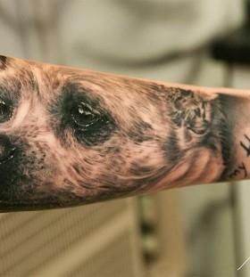 Amazing sad dog tattoo on arm