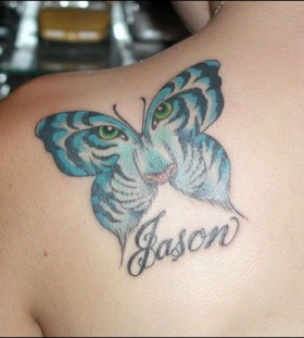 Blue tiger and butterfly in one with eye tattoo on shoulder