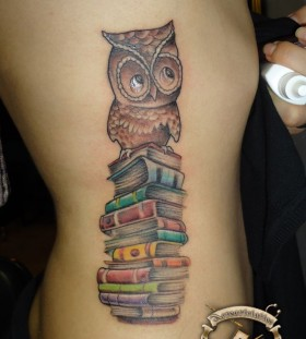 Brown owl and back book tattoo