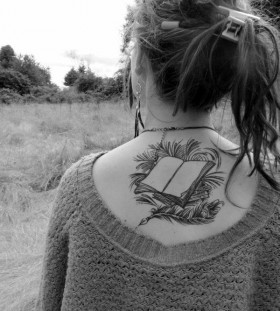 Cool, simple back book tattoo