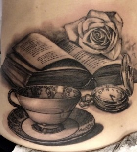 Cup, rose and back book tattoo