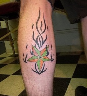 Fire and star tattoo on leg