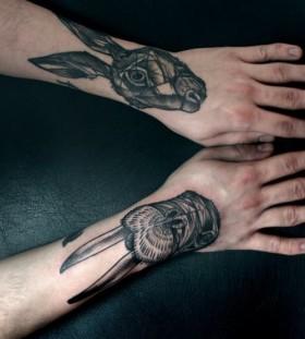 Gorgeous black rabbit tattoo on arm