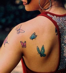 Gorgeous girl butterfly tattoo on arm