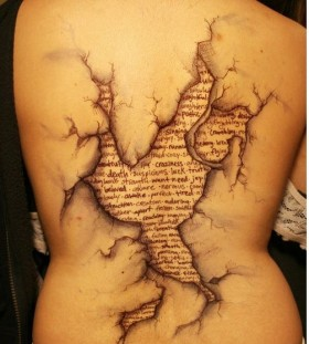 Great letters and back book tattoo