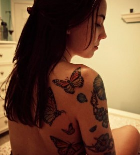 Lovely girl butterfly tattoo on arm