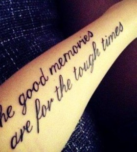 Motivational black quote tattoo on arm