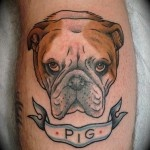 Pig and angry dog tattoo on arm